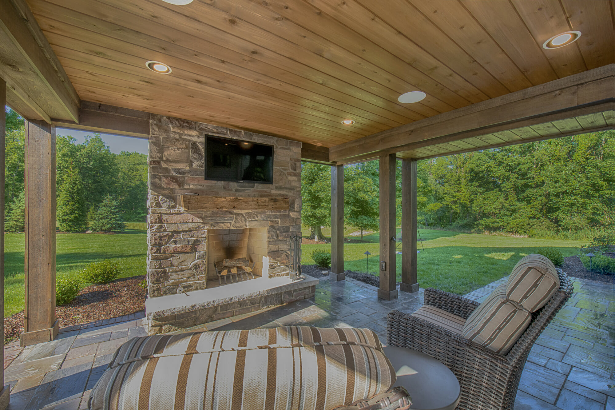 Patio with fireplace and tv